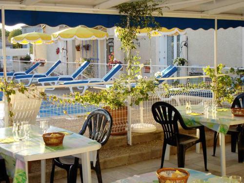 Restaurant ou autre lieu de restauration dans l'établissement Hotel Mucrina