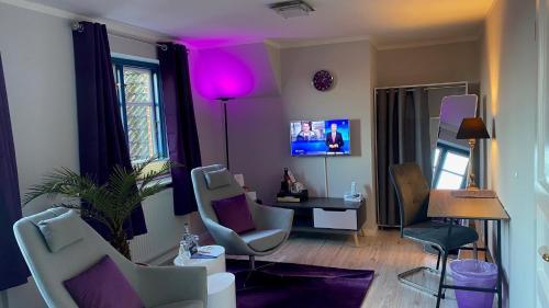 A seating area at Friesenhof Nieblum - Hotel Garni