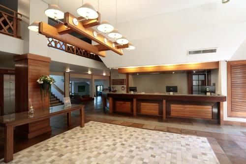 The lobby or reception area at Tri Hotel