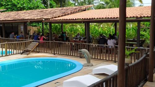 The swimming pool at or near Serrazul Praia Hotel