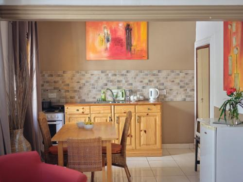 A kitchen or kitchenette at Pelican Residence