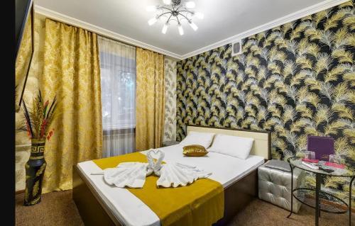 """Кровать или кровати в номере Отель """"На Алексеевской"""""""
