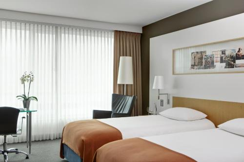 A bed or beds in a room at Steigenberger Airport Hotel Amsterdam