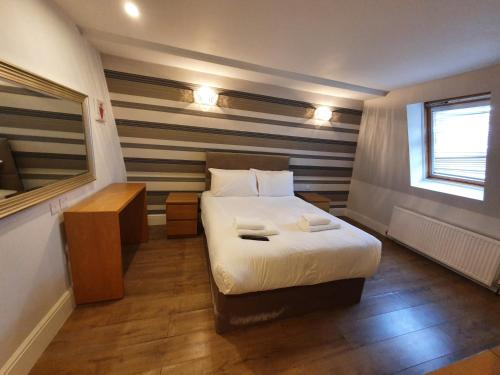 A bed or beds in a room at W6 Hotel