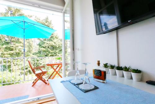 A television and/or entertainment centre at Beachfront Apartment Mala Tereza