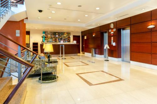 The lobby or reception area at Hotel Marques De Pombal