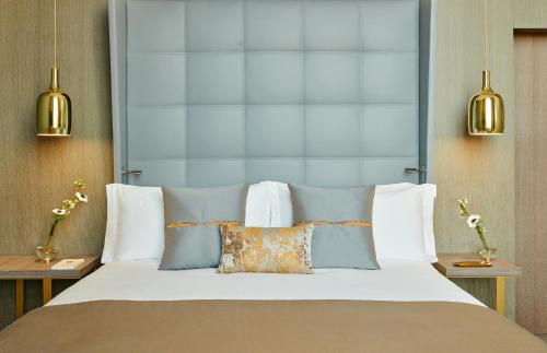 A bed or beds in a room at InterContinental Lyon - Hotel Dieu, an IHG Hotel