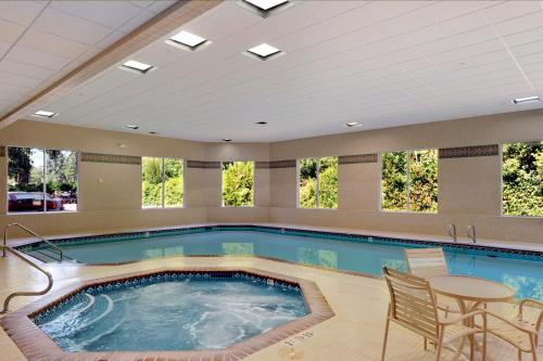 The swimming pool at or near Ramada by Wyndham Olympia