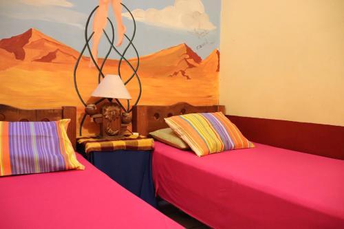 Cama o camas de una habitación en Hostel Casa Zalaoui By Rotamundos