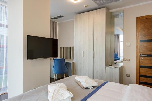 Кровать или кровати в номере Апарт-отель «Золотая Бухта Премиум»