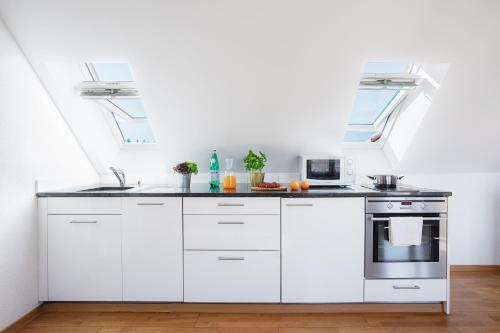 Küche/Küchenzeile in der Unterkunft Swiss Star Apartments - contactless self check-in