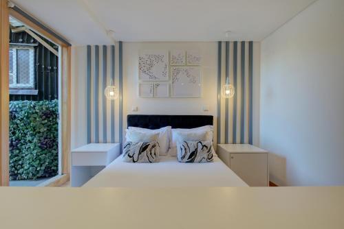 Uma cama ou camas num quarto em PR Suites