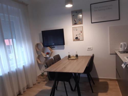 TV a/nebo společenská místnost v ubytování Hendrix'sBridge