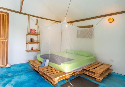A bed or beds in a room at El Zoo Hostel, Bar & Pool