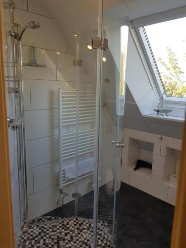Ein Badezimmer in der Unterkunft Ferienhaus Wind