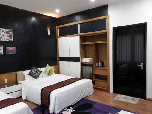 A bed or beds in a room at Đồi Sao Homestay