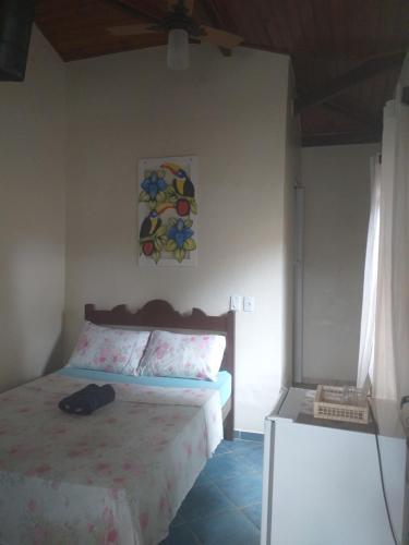 A bed or beds in a room at Pousada Marimbá