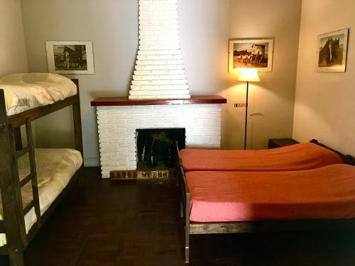 Una cama o camas en una habitación de Areco hospedaje