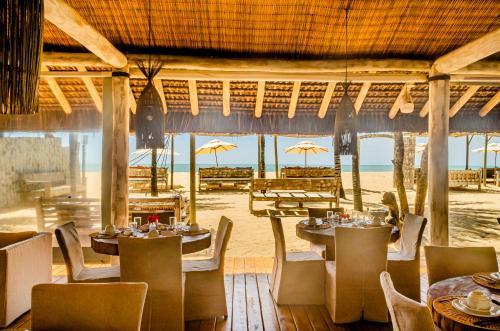 Um restaurante ou outro lugar para comer em Villas de Gaia hotel Boutique