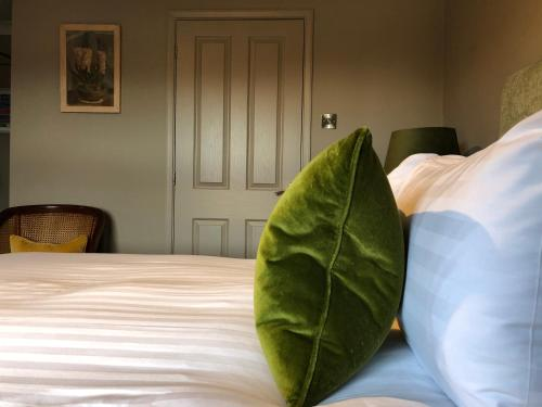 A bed or beds in a room at East Beach Guest House