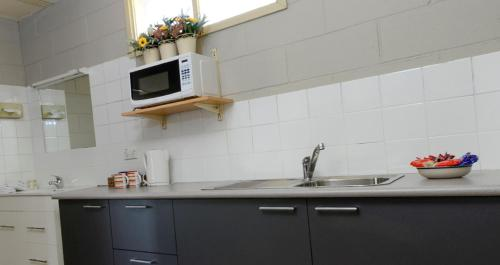 A kitchen or kitchenette at 24Hour Check-In Motels- Bridgewater Motel