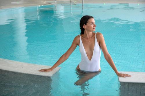 The swimming pool at or near El Faro Hotel & Spa
