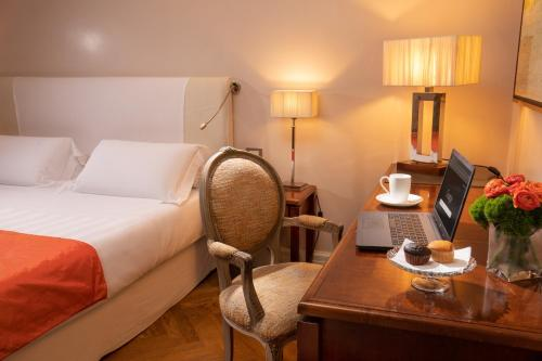 A bed or beds in a room at Vivaldi Luxury Rooms