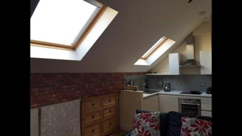 A kitchen or kitchenette at Lime Square Loft