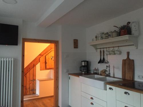 A kitchen or kitchenette at Ferienhaus unterm Schiefen Turm