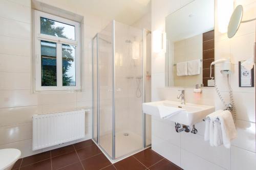 Ein Badezimmer in der Unterkunft Hotel Greive