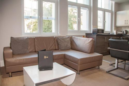 A seating area at Dream Apartments City Center Newcastle