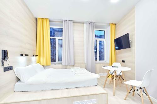 Кровать или кровати в номере White Apart