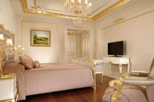 A bed or beds in a room at Be Premium Bodrum