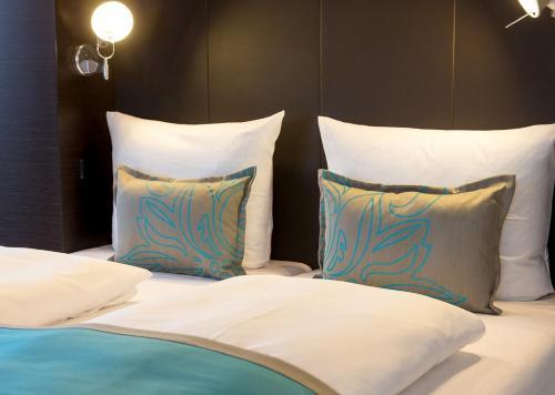 Ein Bett oder Betten in einem Zimmer der Unterkunft Motel One Berlin-Bellevue