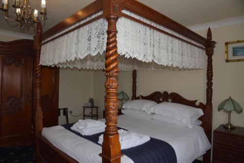 A bed or beds in a room at Dinorben Arms Hotel