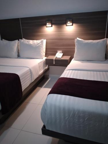 A bed or beds in a room at Hotel MS