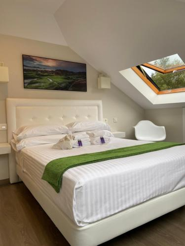 A bed or beds in a room at Pensión MarViva