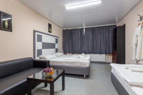 Кровать или кровати в номере Hotel Viven