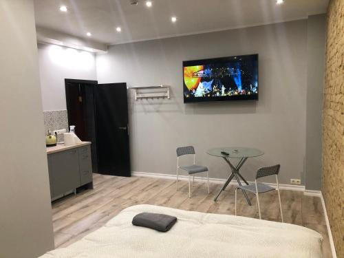 A television and/or entertainment center at ApartHotel Riga