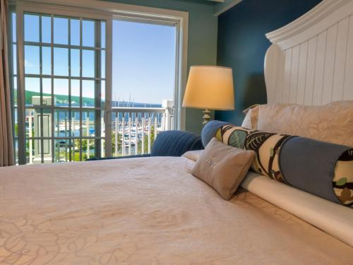 A bed or beds in a room at Watkins Glen Harbor Hotel