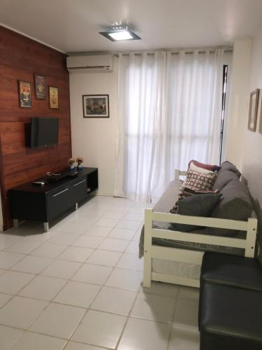 Uma área de estar em Apartamentos Praia de Pajucara