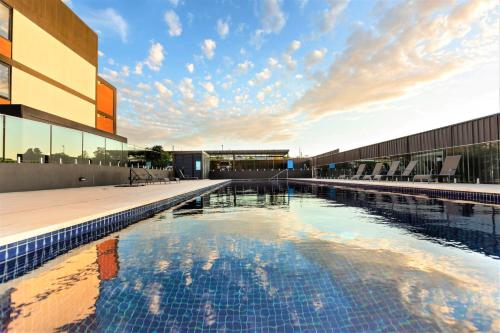 The swimming pool at or near 4 Bedroom Luxury City Penthouse Apartment