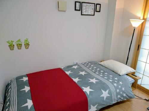 A bed or beds in a room at abc OSAKA