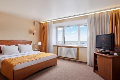 A bed or beds in a room at AZIMUT Hotel Nizhniy Novgorod