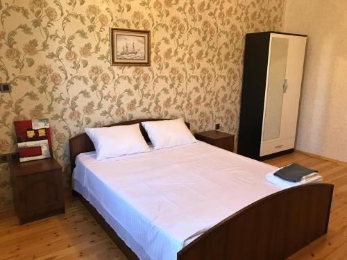 Cama ou camas em um quarto em Senani Villas