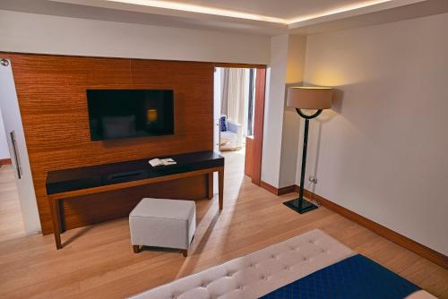 A television and/or entertainment center at TUI BLUE Grand Azur