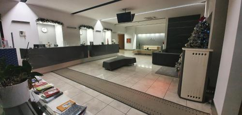 The lobby or reception area at Hotel Artemide