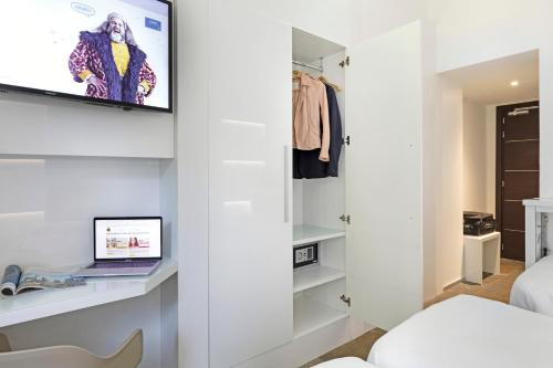 A television and/or entertainment center at B&B Hotel Savona