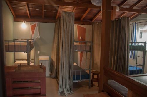 A bunk bed or bunk beds in a room at El Jardin