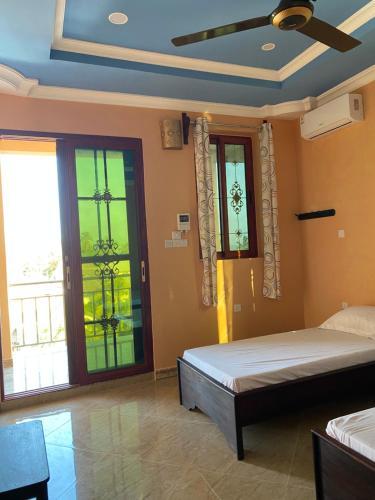 Ein Bett oder Betten in einem Zimmer der Unterkunft Sun Tower live the best of Paje
